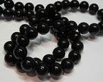 Vaxad glaspärla svart