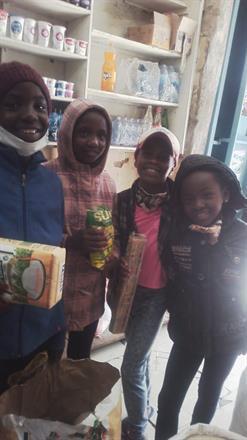 Rozinah family in shop