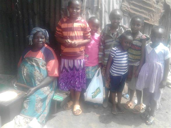 Grandma, Faith and her younger brother and sister + 3 sisters Chenja