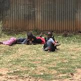 A rare grass area in Kibera