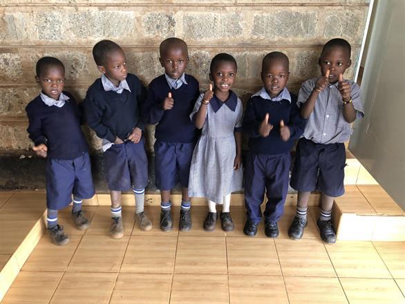 Kibera Nursary - Six students with thumbs up