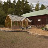 växthus i anslutning till gårdsbutiken