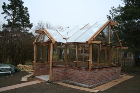 orangeri / växthus på tegelmur