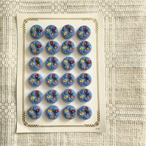 """""""Ljusblå glasknapp med blommor"""" 24st"""