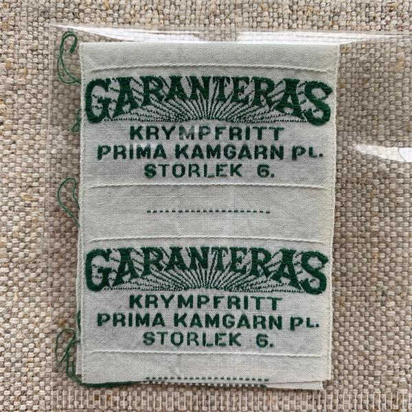 """Garanteras"" tygetikett grön"