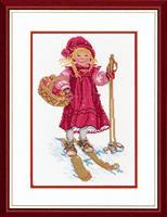 Flicka på skidor