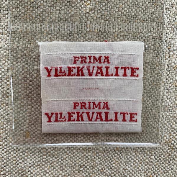 """Prima Yllekvalite"" tygetikett röd"