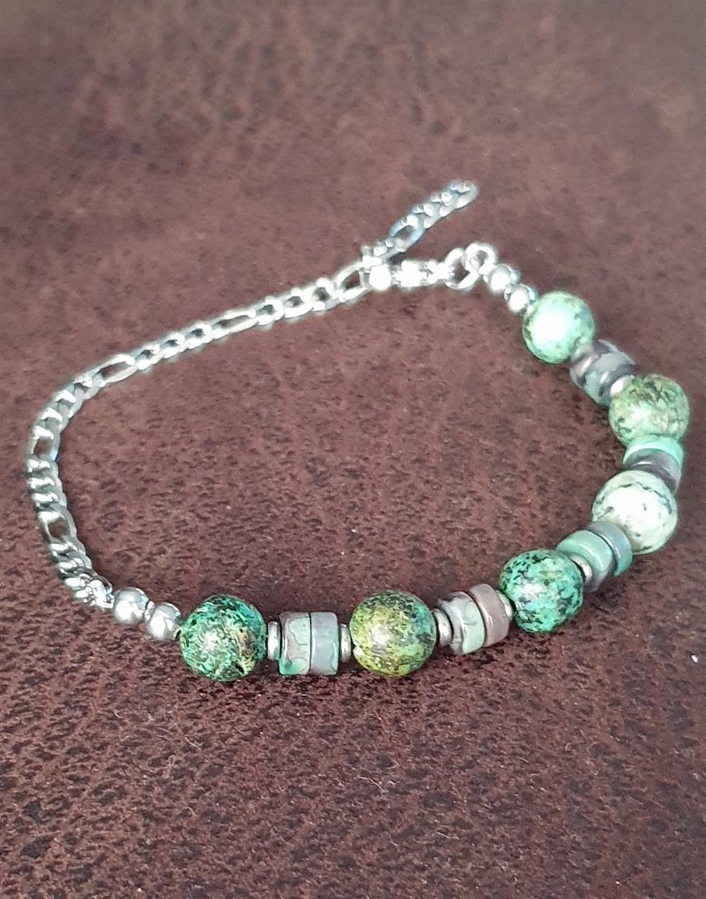 Herrarmband /damarmband stål och stenar
