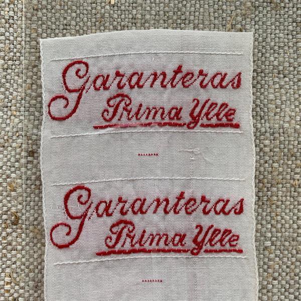 """""""Garanteras Prima Ylle"""" tygetikett röd"""