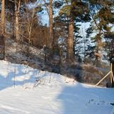 Trädgårdsinhägnad - snö och is släpper snabbt från nätet efter yrväder,..