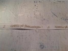 Band med texten Grattis på födelsedagen