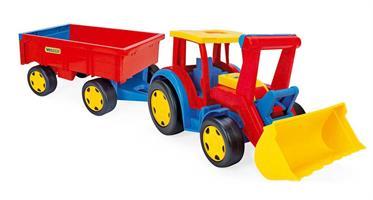 Megatraktor med gräv och vagn