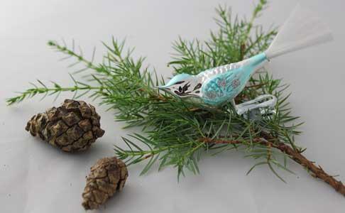 Liten fugl, sølv og isblå