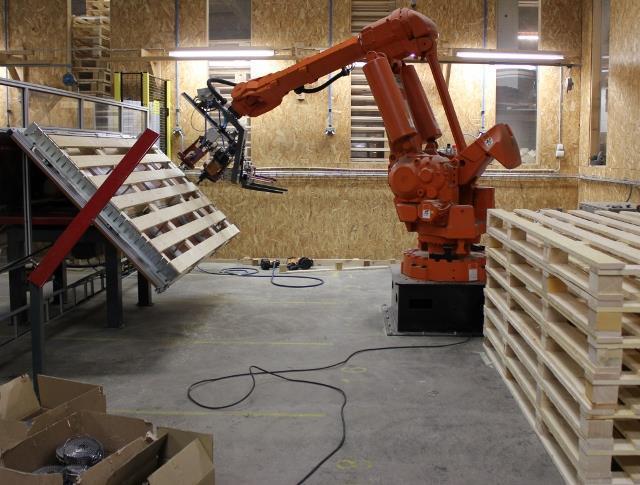 Investering och installation av pallspiksrobot
