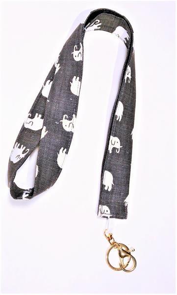 Nyckelband i grått lintyg med elefanter
