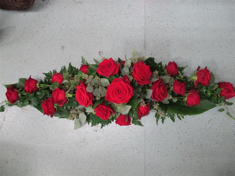 Arkkulaite punainen ruusu